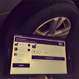 vehicle inspection checklist examining the tires of a ride sharing van